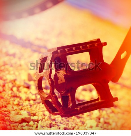 Bike pedal on the country road - stock photo