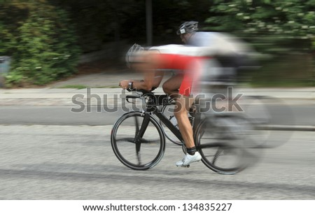 Bike race cyclists at high speed - stock photo