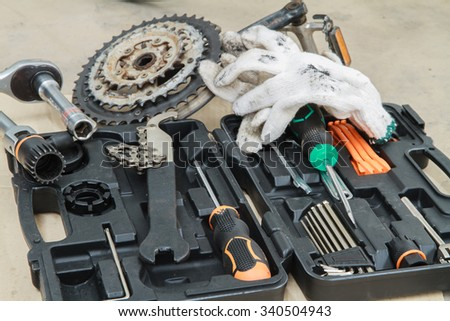 Bike repairing spare parts and tools box - stock photo