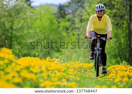 Bike riding - woman on bike, healthy lifestyle concept - stock photo