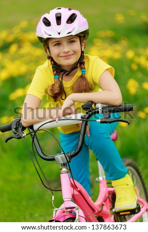 Bike riding - young girl on bike, active child concept - stock photo