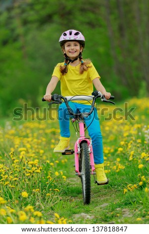 Bike riding - young girl on bike, sporty child concept - stock photo