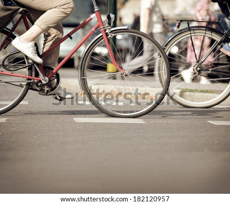Bike(s) in traffic - stock photo