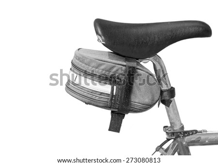Bike seat pack under bicycle saddle. Small saddle pack attached with velcro. Black and white photo. Isolated on a white background. Room for text, copy space.  - stock photo