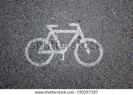 Bike symbol on road background - stock photo
