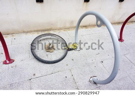 bike theft with locked wheel - stock photo