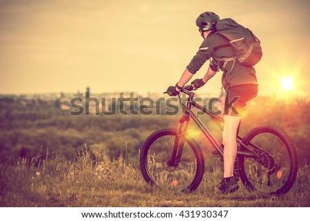 Bike Trip with City View. Scenic Bike Trail. Caucasian Men on the Bike. - stock photo