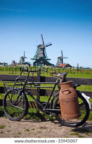 Bike with milk-can and windmills at Netherlands - stock photo