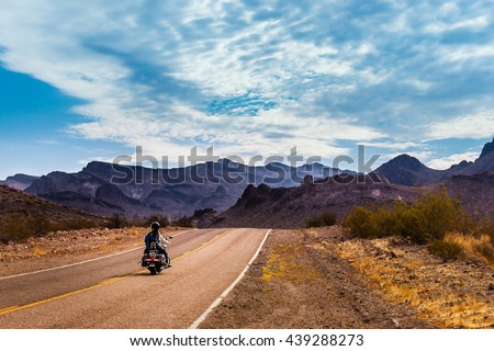 Biker driving on the Highway on legendary Route 66 to Oatman, Arizona. - stock photo
