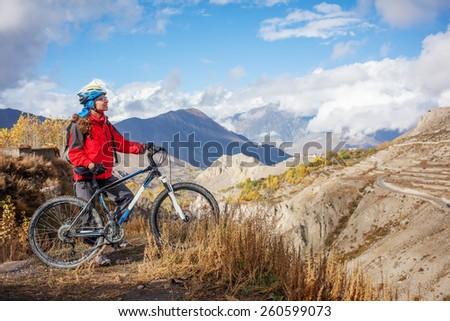 Biker-girl in Himalaya mountains, Anapurna region - stock photo