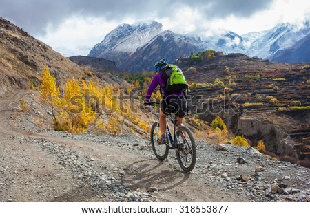 Biker-girl in Himalaya mountains, Annapurna region - stock photo
