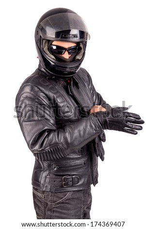 Biker in leather jacket with helmet, isolated on white. - stock photo
