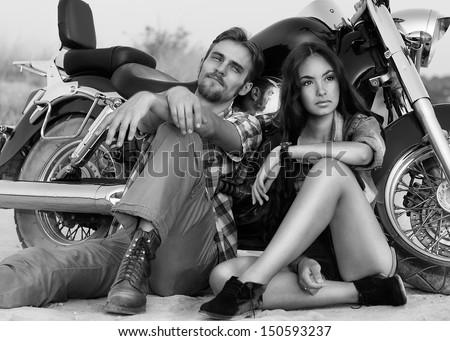 Biker man and girl - stock photo