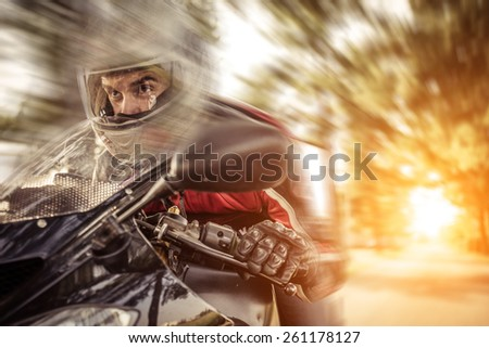 biker riding fast with his motorbike at sunset. concept about transportation and motors. blur effect - stock photo