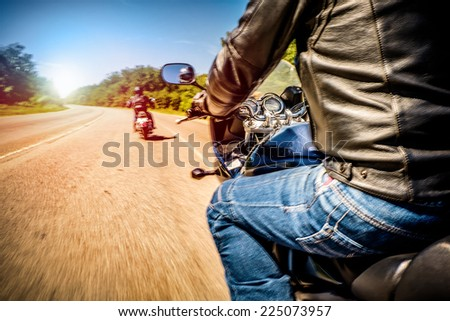 Bikers driving a motorcycle rides along the asphalt road (blurred motion). First-person view. Focus on the dashboard of a motorcycle - stock photo