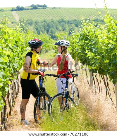 bikers in vineyard, Czech Republic - stock photo
