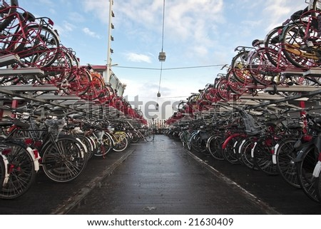Bikes, bikes and bikes in Amsterdam Netherlands - stock photo
