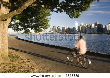 Biking in City Park - stock photo