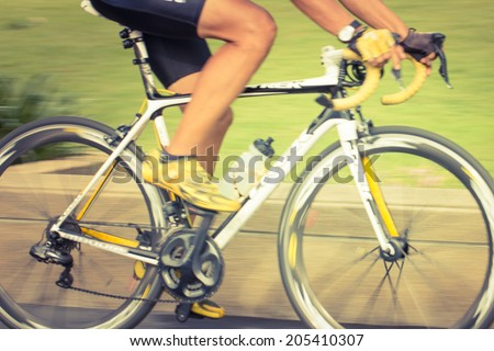 Biking taken with low speed shutter - stock photo