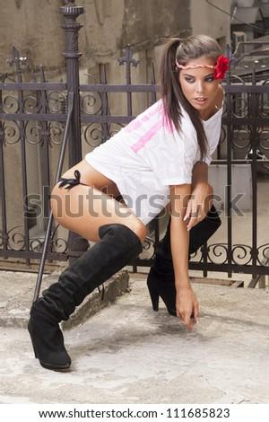 Bikini Fashion Model in fashionable boots. - stock photo