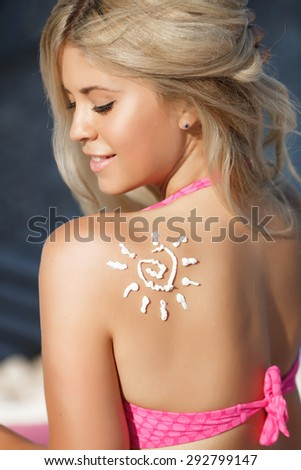 Bikini woman with suntan lotion at beach, sexy tanned girl in swimsuit outdoors portrait, happy female at summer vacation, glamour blonde lady in swimwear at pool, young woman at sea, series - stock photo