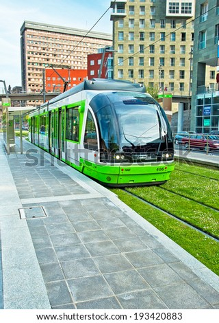BILBAO, SPAIN - APRIL 25, 2010: The tram lane covered with grass in Bilbao, Spain on 25 April 2010. You can travel by different means of transport in the city of Bilbao. - stock photo