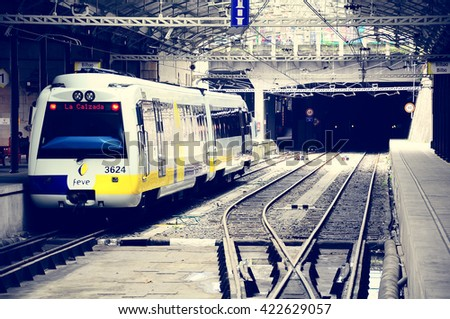 Bilbao, Spain - June 10, 2010: Passenger diesel train of Feve railway company stands at the underground station. Feve railway connects Hendaye (France) and Ferrol (northwest Spain). - stock photo