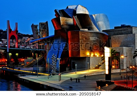BILBAO, SPAIN - NOVEMBER 14: The Guggenheim Museum and the estuary at evening on November 14, 2012 in Bilbao, Spain. This picturesque and futuristic museum was designed by Frank Ghery - stock photo