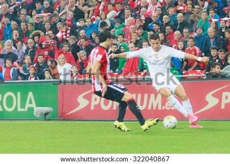 BILBAO, SPAIN - SEPTEMBER 23: Cristiano Ronaldo dribbles an opponent in the San Mames Stadium, on September 23, 2015 in Bilbao, Spain - stock photo
