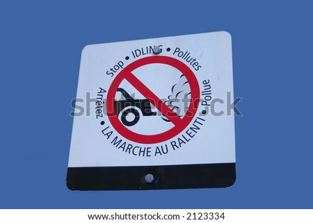 bilingual stop idling sign in french and english - stock photo