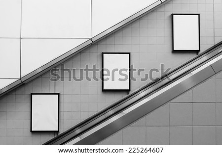 bill board ads at escalator side - stock photo