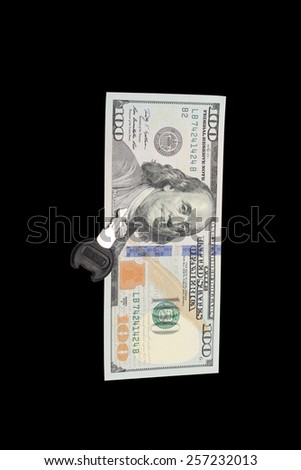 bill in one hundred dollars and a key - stock photo