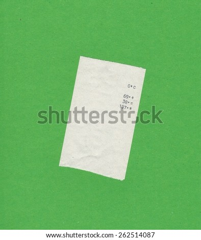 bill or receipt isolated over green background - stock photo