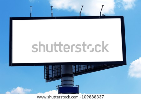 Billboard against blue cloudy sky, in the street by day - stock photo