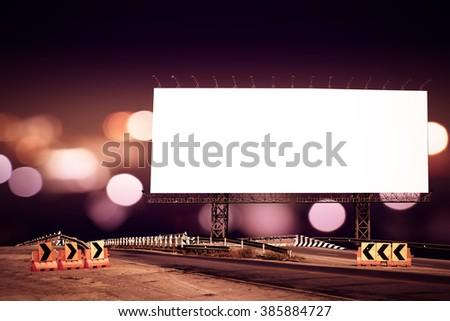 billboard and bridge with bokeh light in city night time - stock photo