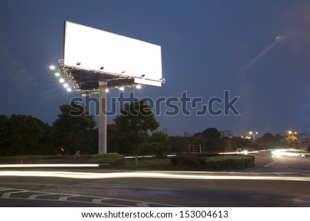 Billboard at night light trails - stock photo