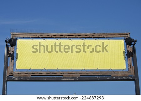 billboard ideal for restaurant with blue sky as background - stock photo