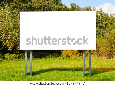 Billboard with empty screen standing in a field - stock photo