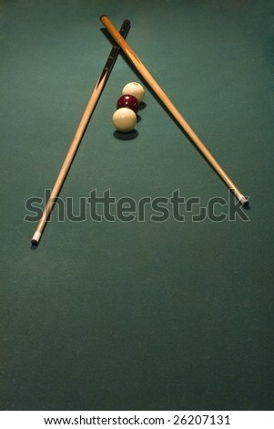 billiard balls and cue on table - stock photo