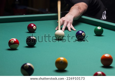 Billiard balls in a pool table.stroke; focus on the white ball - stock photo