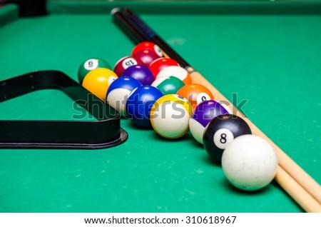 Billiard balls on green table with billiard cue, Snooker, Pool game. - stock photo