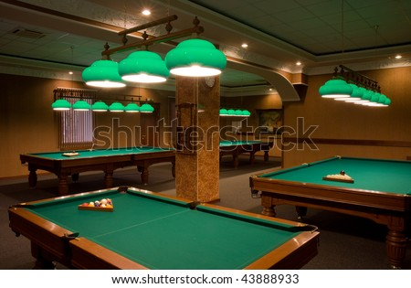 billiard tables in empty room - stock photo