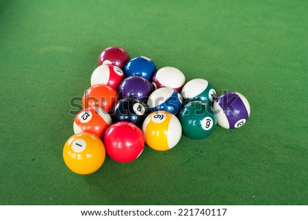Billiards. Top view of billiard balls and cues on green table - stock photo