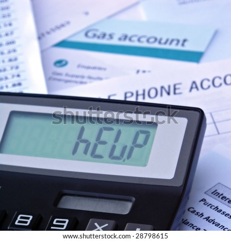 Bills and calculator displaying HELP - stock photo