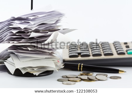 Bills in paper nail on business desk - stock photo