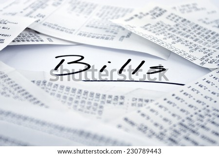 Bills to be paid in monthly periods - stock photo