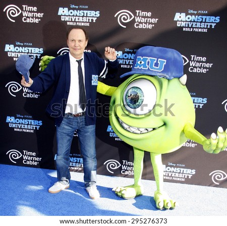 "Billy Crystal at the Los Angeles Premiere of ""Monsters University"" held at the El Capitan Theatre in Hollywood on June 17, 2013 in Los Angeles, California.   - stock photo"