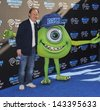 "Billy Crystal at the world premiere of his movie ""Monsters University"" at the El Capitan Theatre, Hollywood. June 17, 2013  Los Angeles, CA - stock photo"