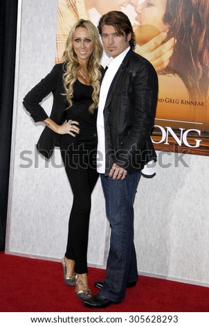 Billy Ray Cyrus and Tish Cyrus at the Los Angeles premiere of 'The Last Song' held at the ArcLight Cinemas in Hollywood, USA on March 25, 2010. - stock photo