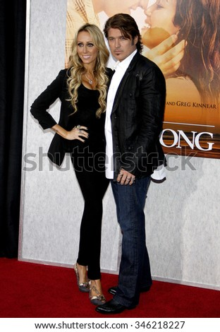 "Billy Ray Cyrus and Tish Cyrus at the World Premiere of ""The Last Song"" held at the ArcLight Cinemas in Hollywood, USA on March 25, 2010. - stock photo"